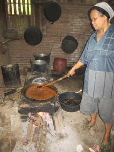 A farmer boiling coconut sap into sugar