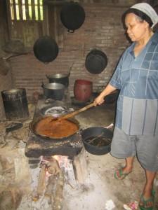 A farmer boiling coconut sap into sugar