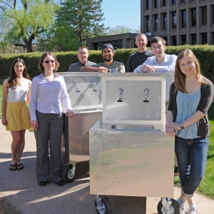 The designers and builders of the first Wishing Well prototypes (from left): Nina Gerona '15, Jen Kleindienst (Sustainability Coordinator), Bruce Strickland (Machine Shop), Tavo True-Alcala '15, Dave Strickland (Machine Shop), Brent Packer '15, and Madeleine O'Brien '16