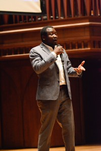 """Kennedy Odede '12 founder of Shining Hope for Communities (SHOFCO) and co-author of the new book """"Find Me Unafraid: Love, Loss, and Hope in an African Slum,"""" spoke at Memorial Chapel on Nov. 6 about their work in Kibera, Kenya. (Photo by John Van Vlack)"""
