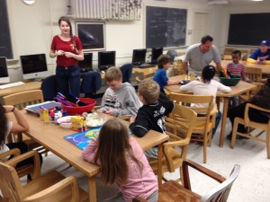 Hannah Fritze doing space-themed arts and crafts with kids.