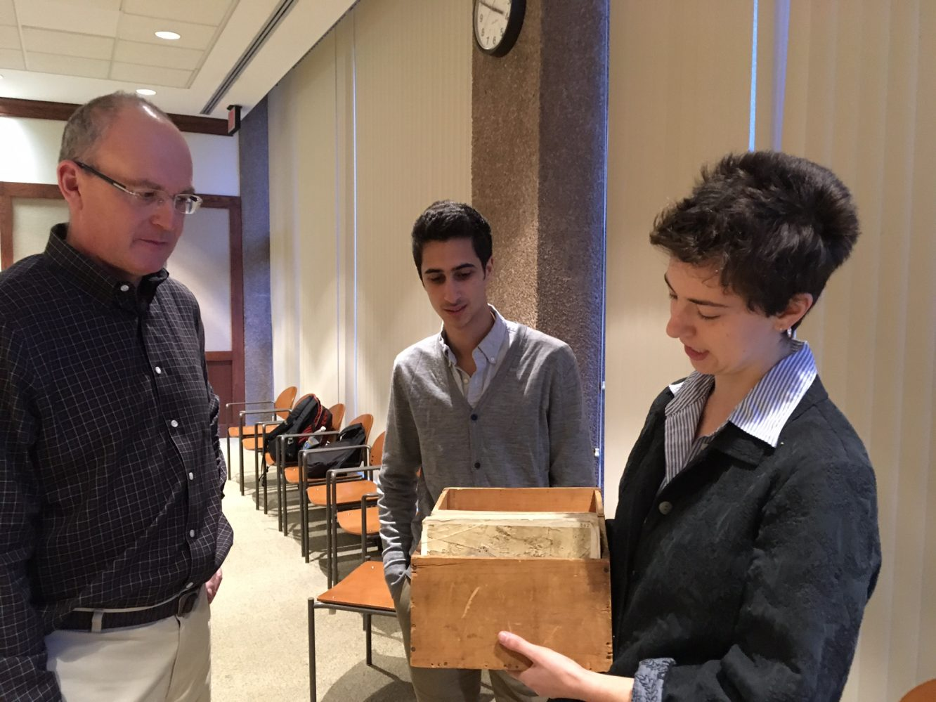Louisa Winchell and Mat Shelley-Reade returning the box of 1922 aerial photographs used for their project to Roger Palmer (City of Middletown).