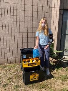 Lydia Cox '22 with the MHRI's rover